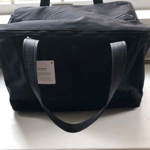 NWT Lululemon Out of Range black duffel bag!